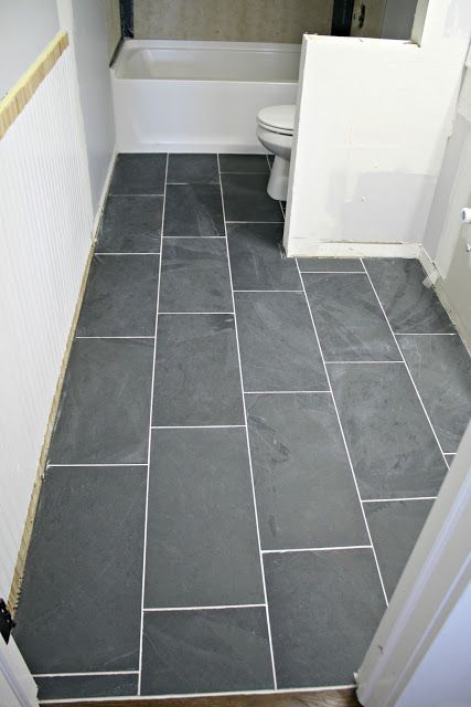How to tile a bathroom floor  it s done       DIY LIfe   Pinterest     How to tile a bathroom with dark gray slate 12x24 tile   isn t it gorgeous