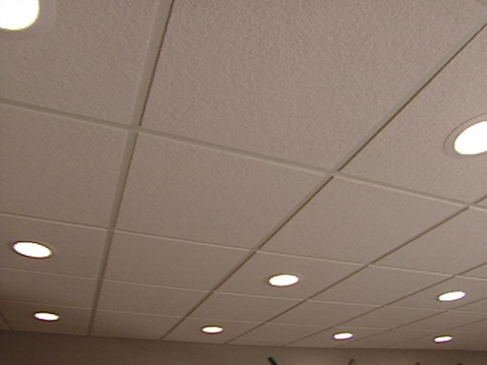 A drop or suspended ceiling offers a way to both conceal