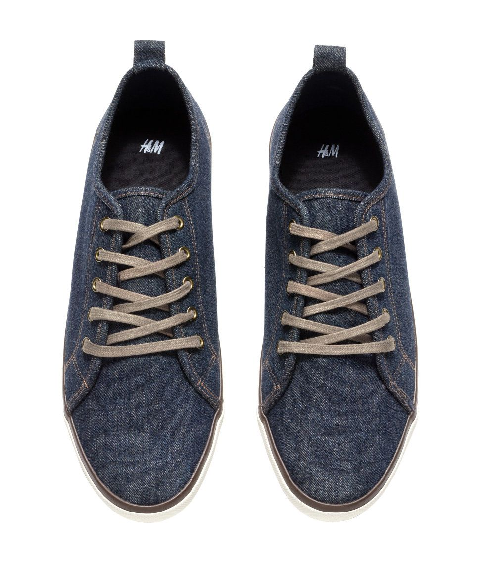 e8dc0ff8a5f1 Blue denim sneakers with front laces   rubber soles.