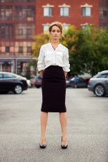 Young fashion business woman standing on the car parking stock photo