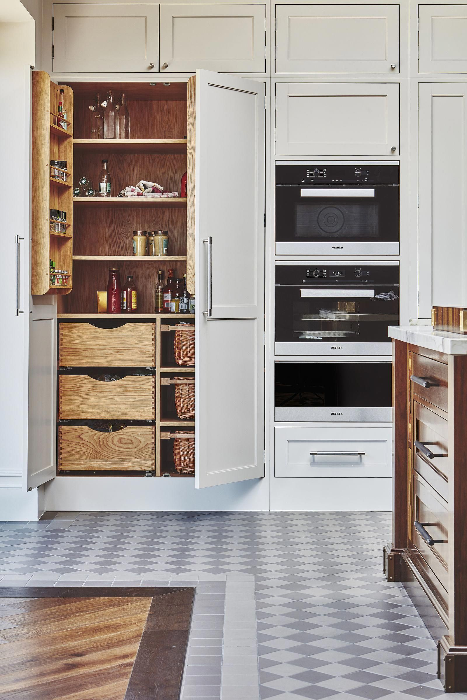 Built in Larders. Also - look at the floor - tiles meets wooden flooring. Done nicely. Wooden interior of Larder compliments wooden flooring really well. #kitchendesign