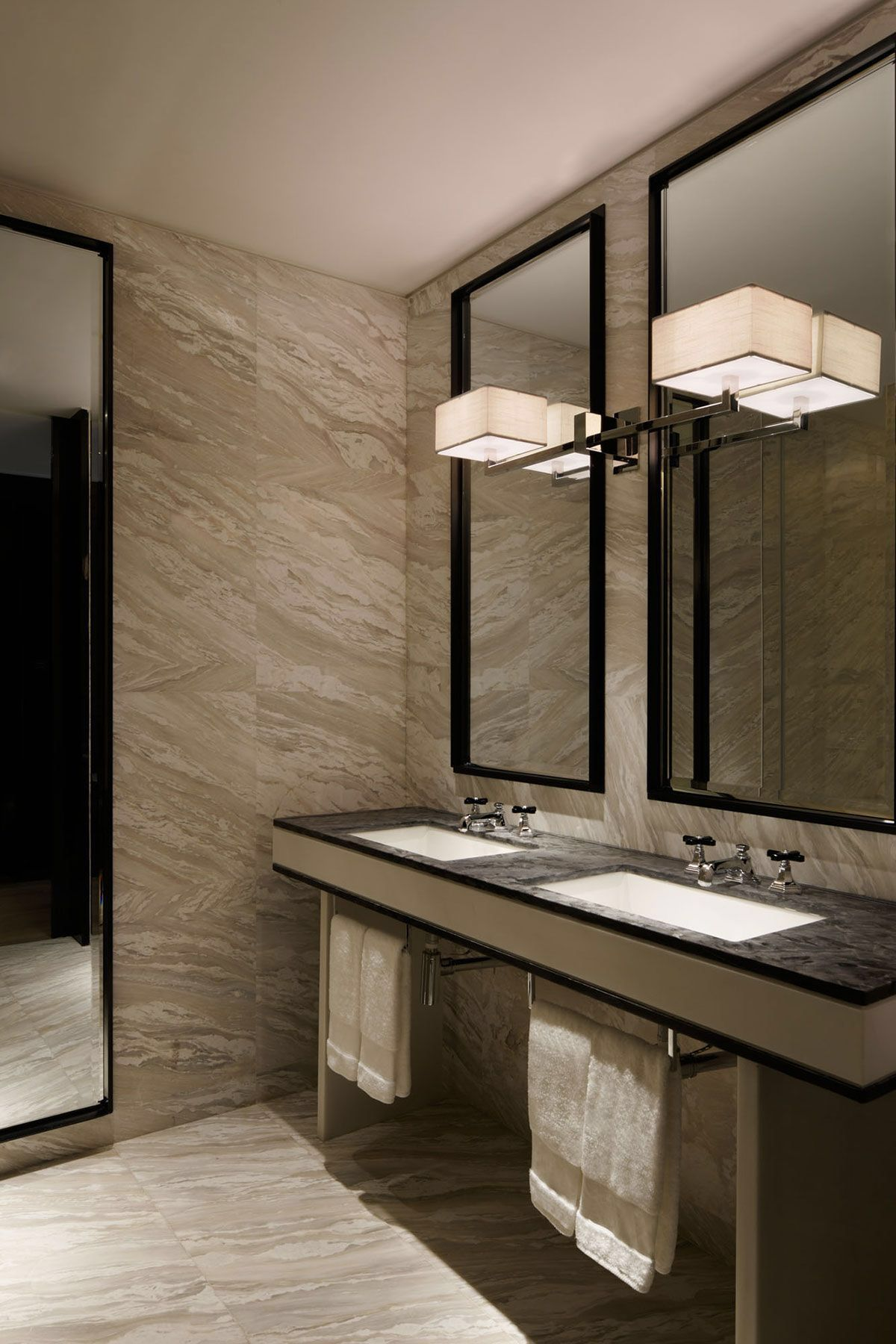 Yabu Pushelberg  W Hotel Guangzhou. This grey bathroom has a masculine element   large block tiles and