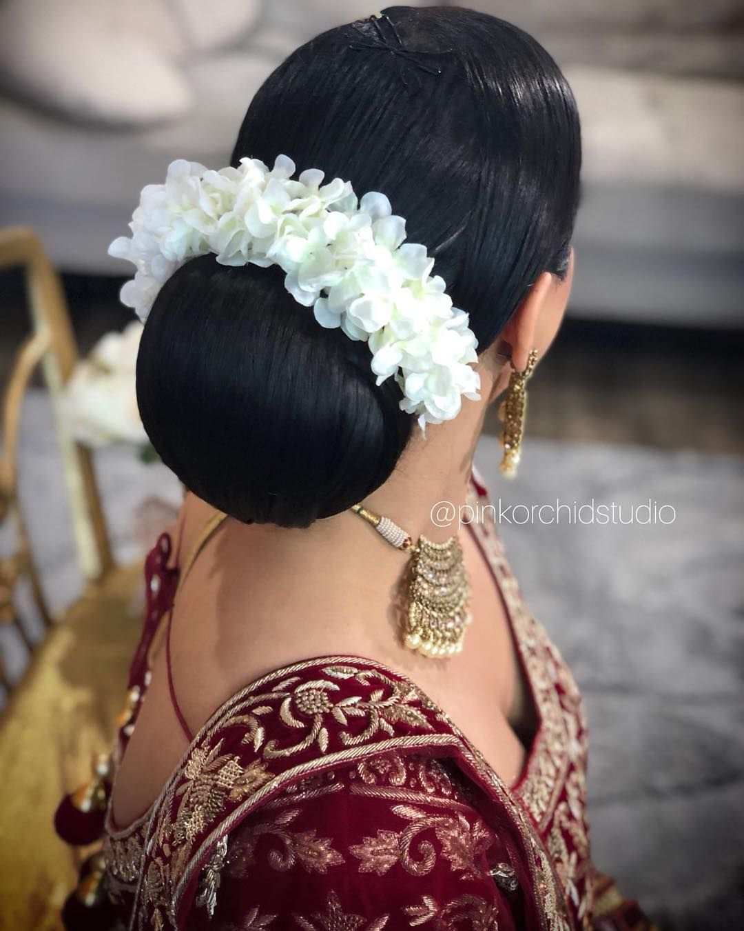 South Indian Bridal Reception Hairstyle Hair Bun With Orchids Indian Bridal Hairstyles Long Hair Styles Hair Styles