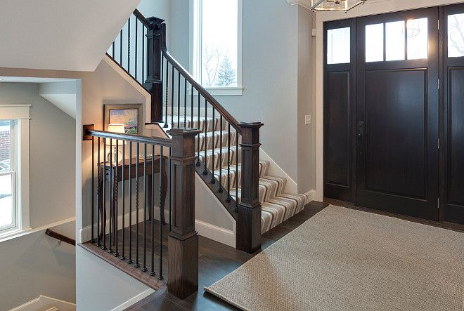 Front Entry Foyer With Dark Stained Wood Door Hardwood Floors Staircase Railing And Newel Post Grace Hill Design