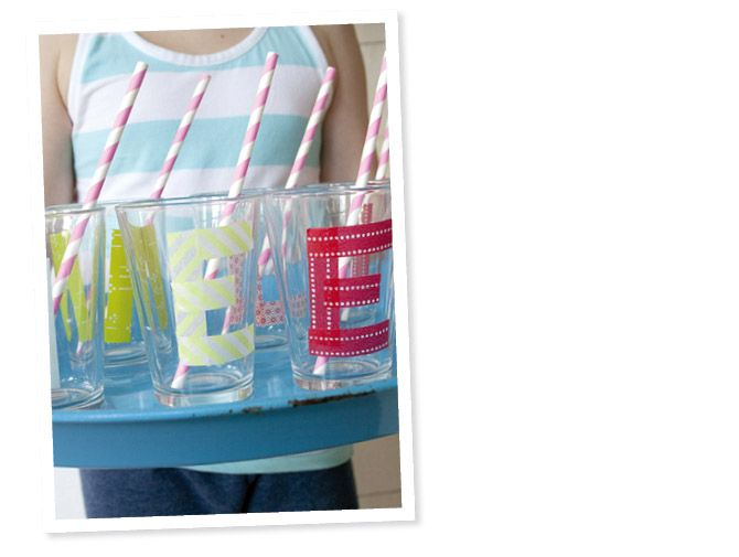 Washi tape letters on your party glasses.