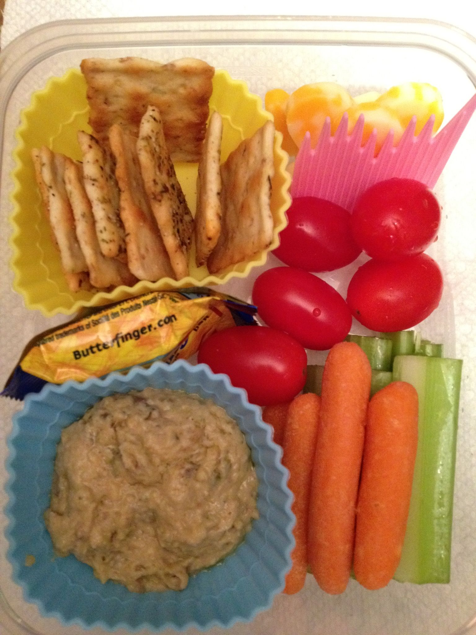 Vegetarian bento lunch - hummus, crackers, cheese cutouts, fresh veggies for dipping