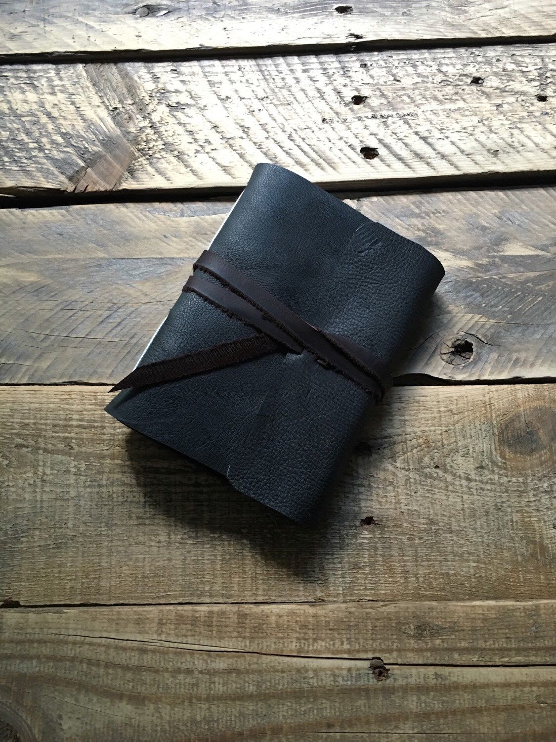 A personal favorite from my Etsy shop https://www.etsy.com/listing/255556981/dark-grey-wrap-tie-journal-medium