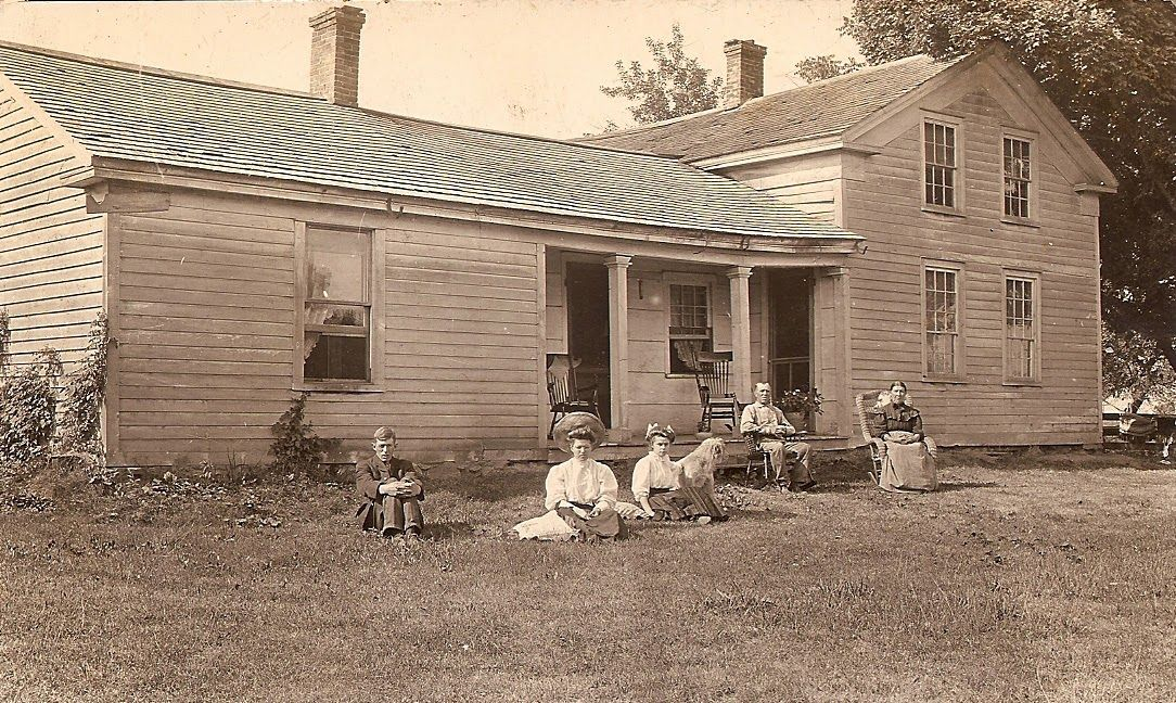 Greek Revival Farmhouse early 1900s photo of a simple michigan greek revival farmhouse