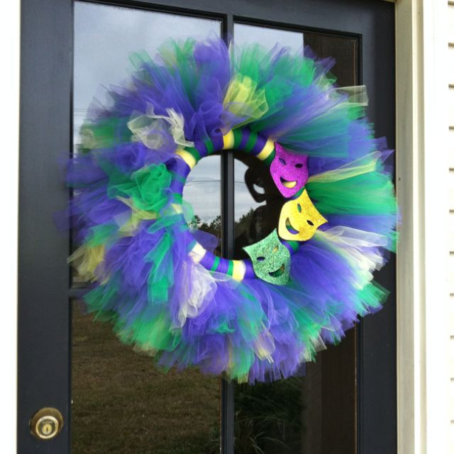 My new Mardi Gras wreath! I made it with 7 rolls of tulle and a styrofoam circle. Love it!