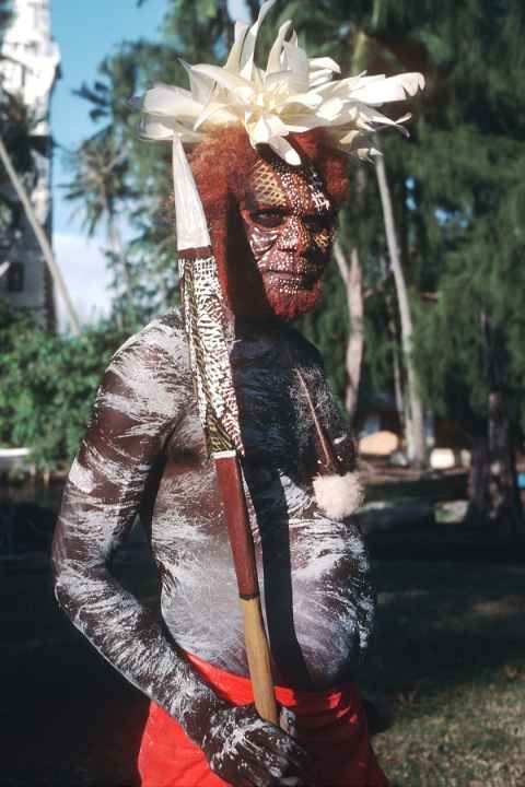 A Bathurst Island man, painted up for a traditional Tiwi dance with his carved spear at Point Venus, Tahiti during the Festival of Pacific Arts.