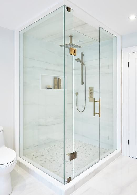Perfectly designed seamless glass shower is fitted with marble herringbone  floor tiles complementing marble walls that frame a niche and hold a modern  brass  Perfectly designed seamless glass shower is fitted with marble  . Marble Walls For Shower. Home Design Ideas