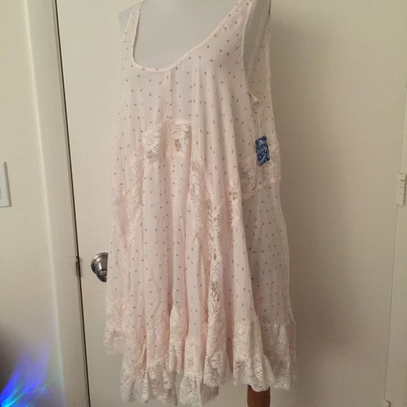 Free people She Swings slip ivory combo M NWT New with tags free people she swings. Ivory combo size medium. Accidentally bought two. Guessed I liked it lol. This is very roomy. I usually get a large in the trapeze slip. Never worn Free People Dresses Mini