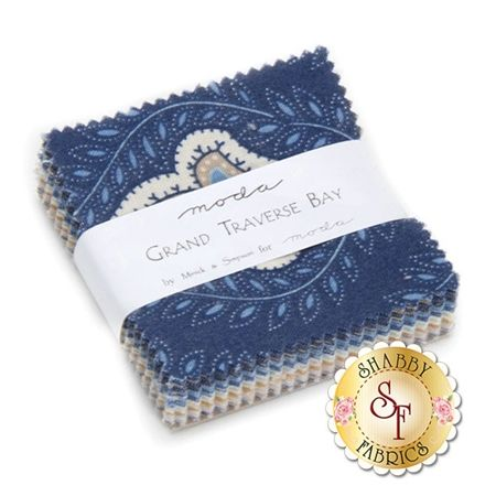 """Grand Traverse Bay Mini Charm Pack by Minick And Simpson for Moda Fabrics Grand Traverse Bay is a collection by Minick And Simpson for Moda Fabrics. 100% cotton. This mini charm pack contains 42 squares, each measuring 2 1/2"""" x 2 1/2""""."""