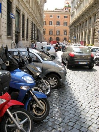 Rome, Italy by c. jenkins  little cars and motorbikes.