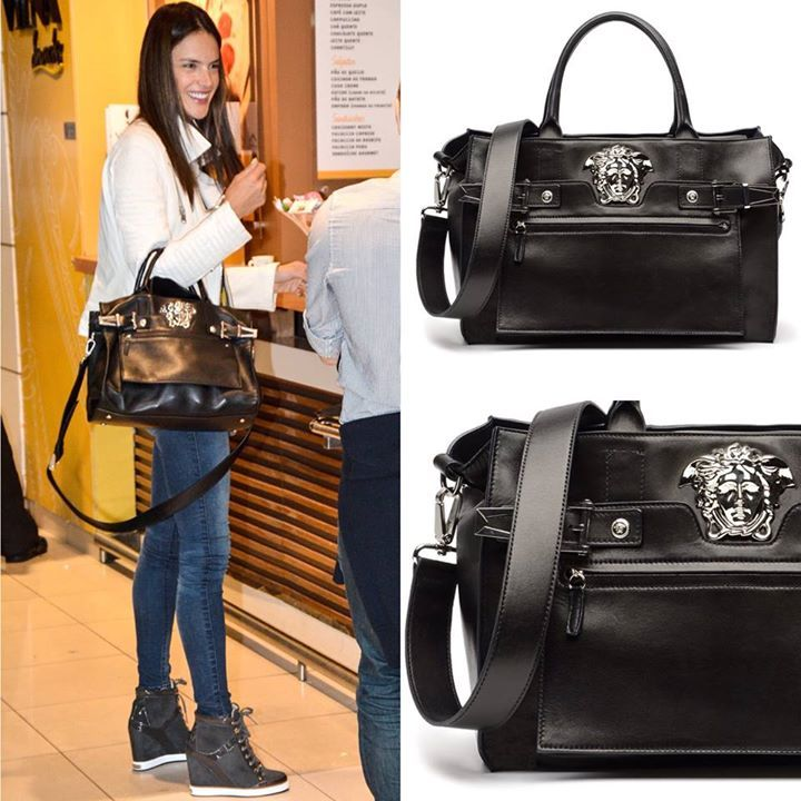 b953e1a8c5 Supermodel Alessandra Ambrosio definitely knows how to travel in style. She  was spotted carrying an iconic black Versace palazzo bag