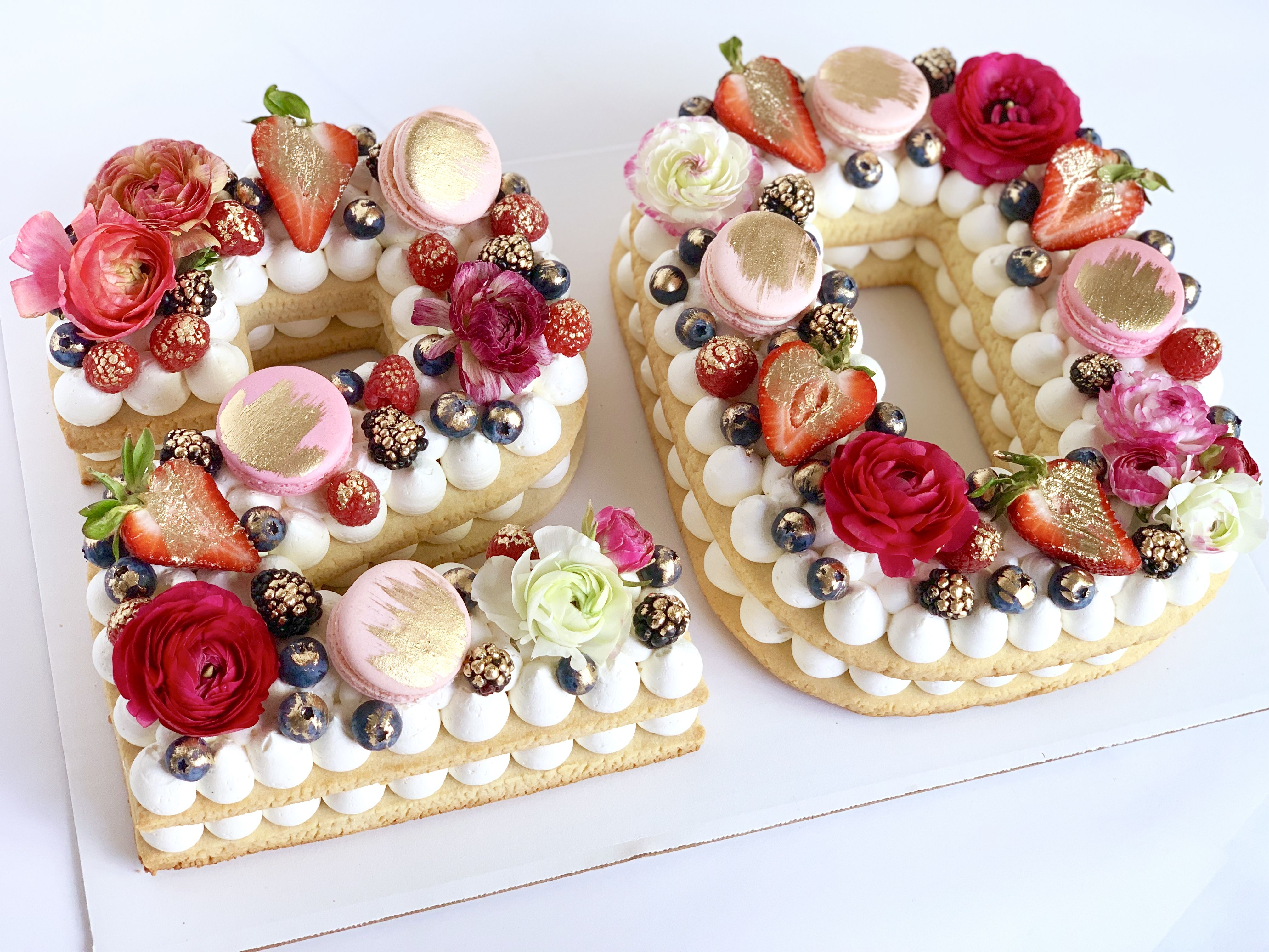 Cookie cake with flowers macaroons and fresh fruits