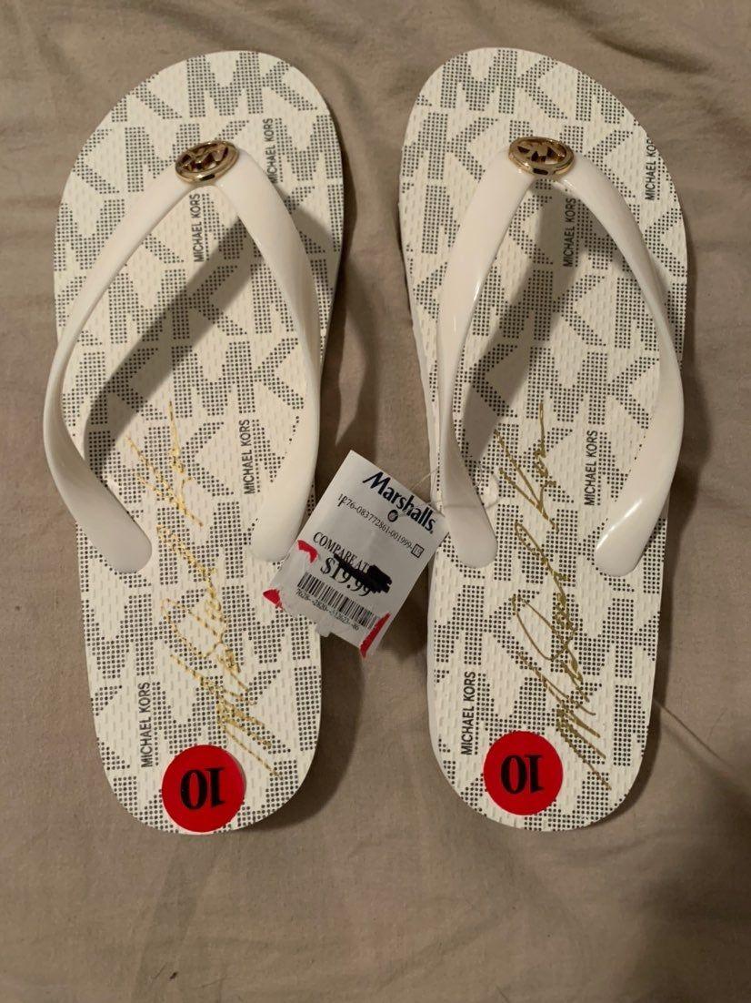 Michael Kors flip flops. Never worn
