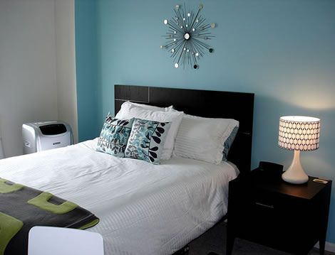 Bedroom Colour Catalogue blue accent wall, espresso-brown bed, modern accessories. perfect