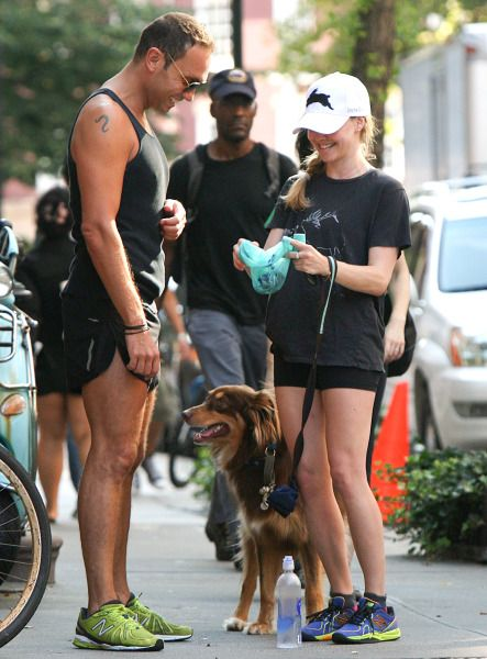 Amanda Seyfried in the New Balance 997 Cross-Trainer. Mystery man in the 890v2.