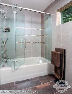 this bath tub has a frameless glass door without the annoying
