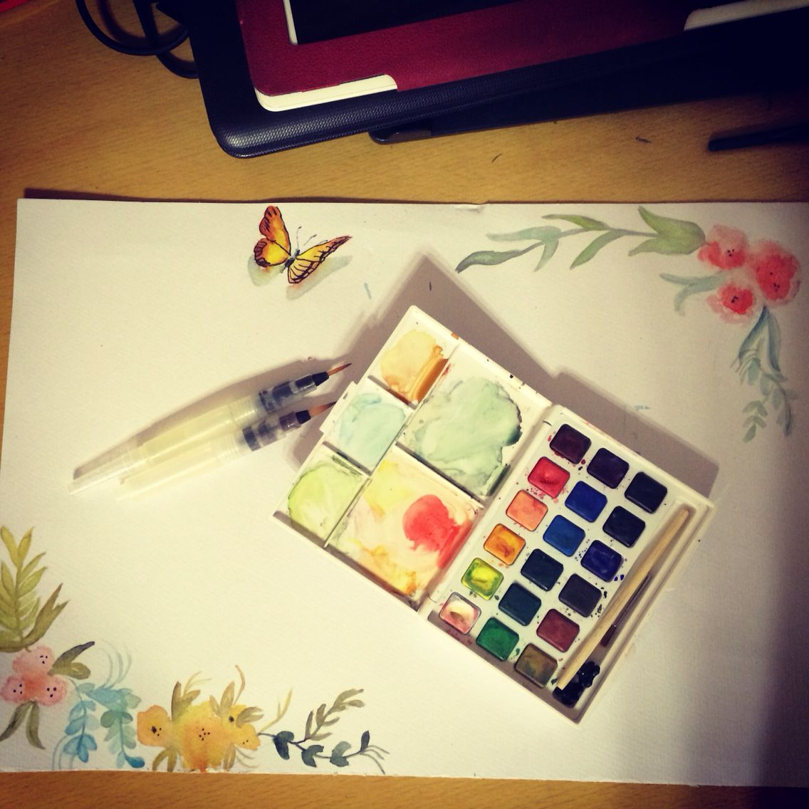 Watercolor butterfly and flowers
