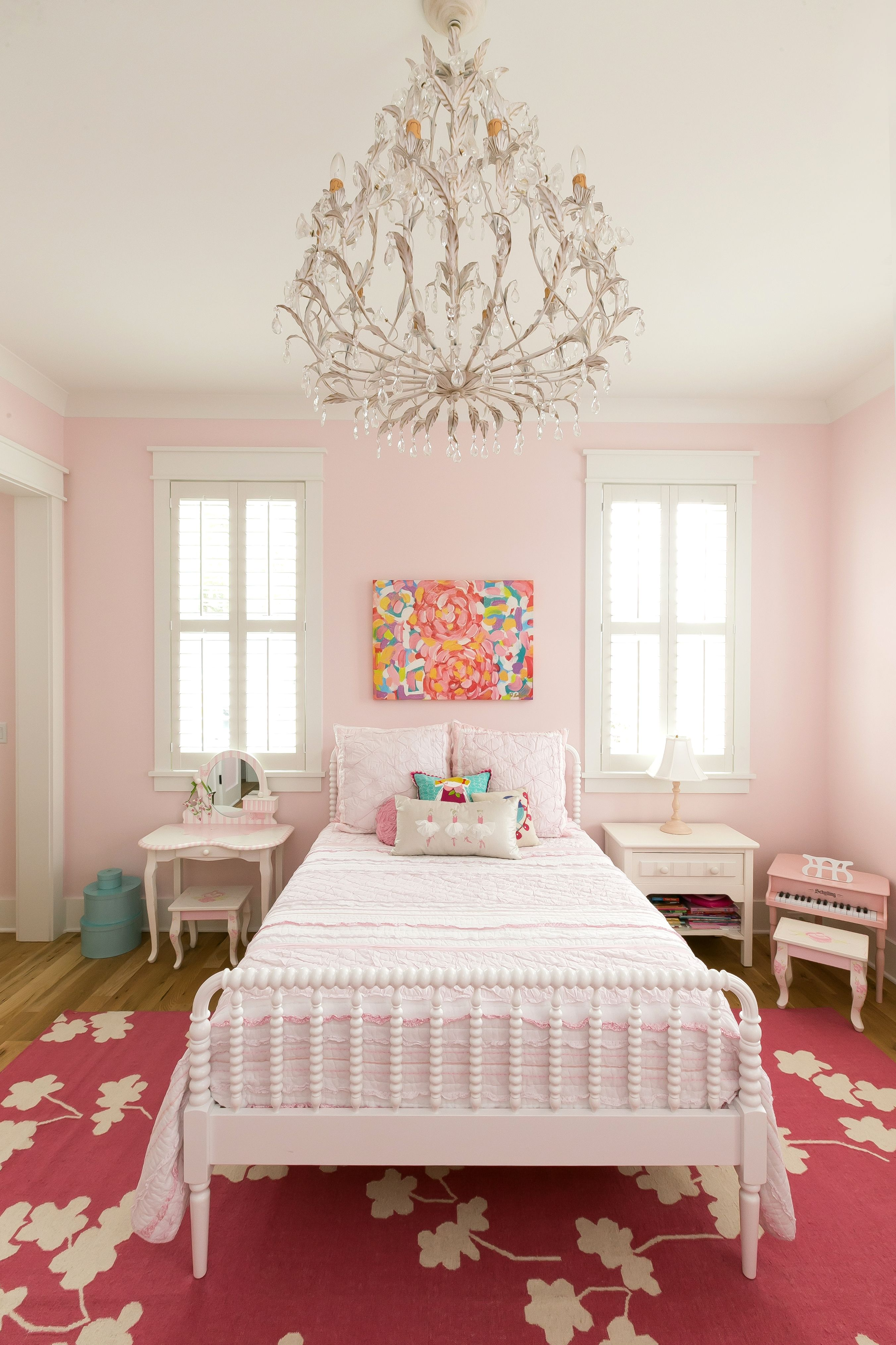 Girls room painted in Sherwin Williams Elephant Pink paint with a