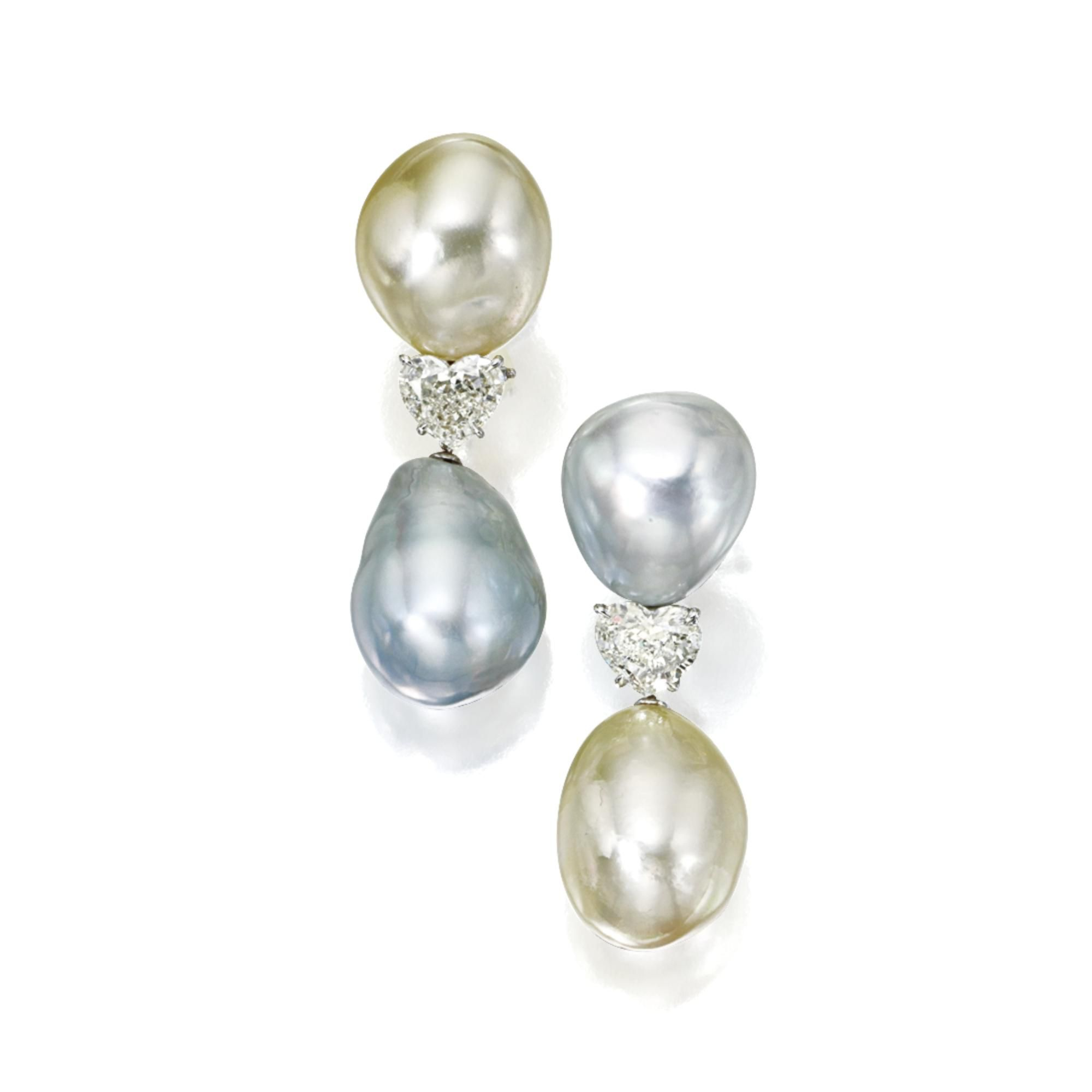 PAIR OF CULTURED PEARL AND DIAMOND PENDANT-EARCLIPS The tops set with 2 baroque cultured pearls of natural pale gold and light gray color, measuring approximately 18.7 by 16.6 mm. and 18.1 by 16.0 mm. respectively, supporting 2 cultured pearl drop pendants of natural light gray and pale gold hue, measuring approximately 21.8 by 17.1 mm. and 21.4 by 16.5 mm., separated by 2 heart-shaped diamonds weighing 1.71 and 1.80 carats, mounted in platinum. Estimate 35,000 — 45,000