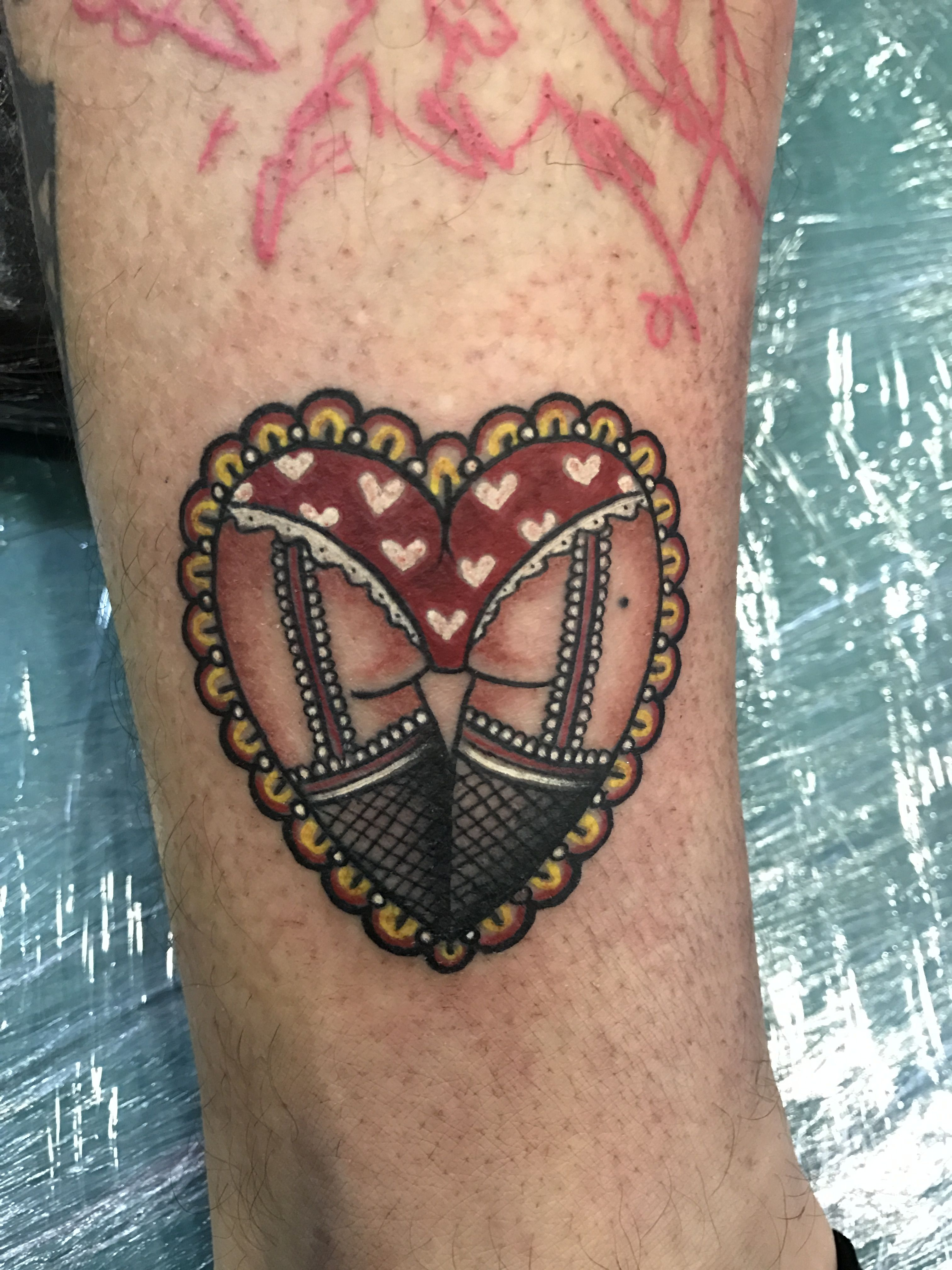 Booty heart tattoo