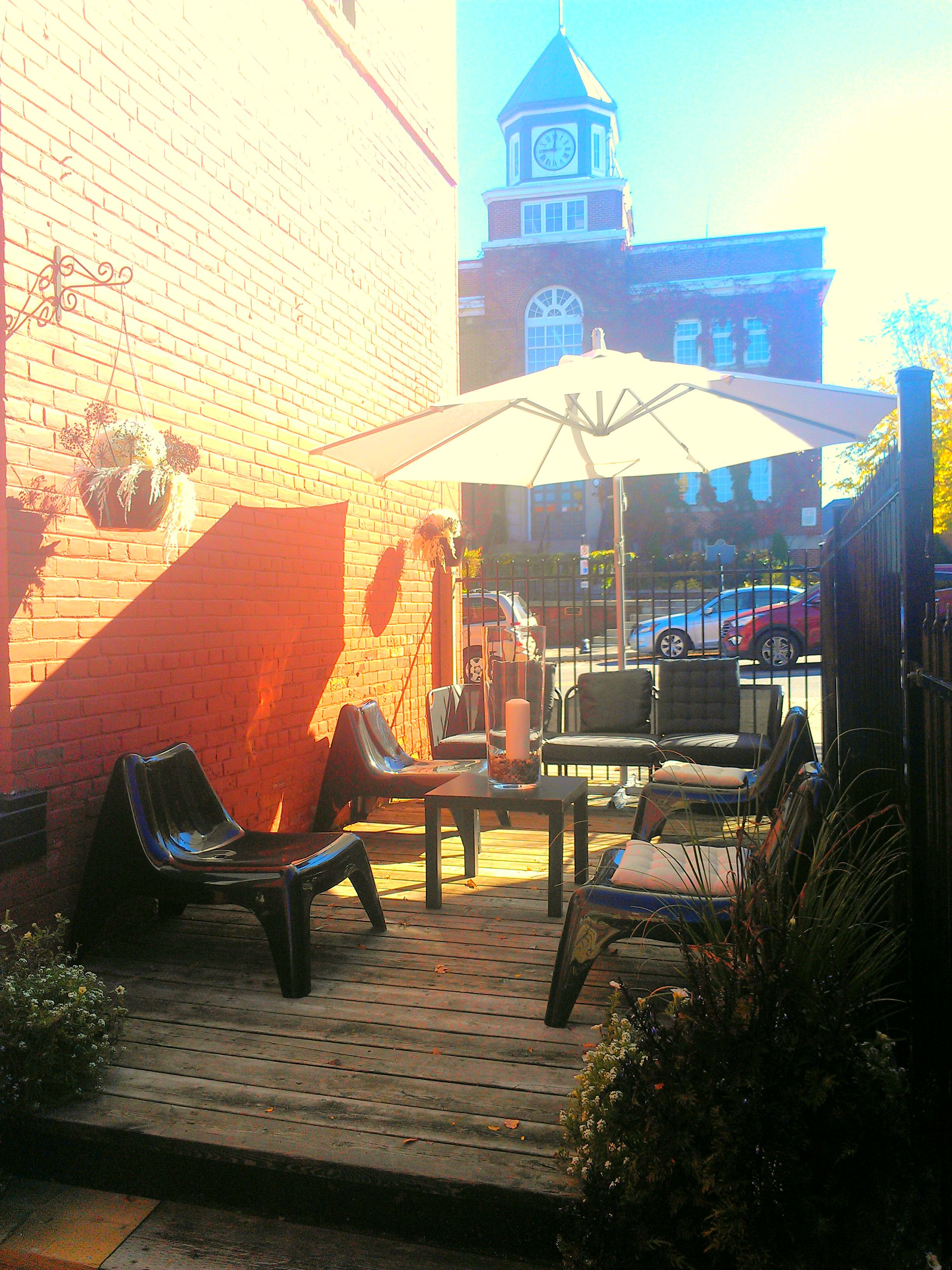 Beautiful outdoor patio for clients to relax outside the salon