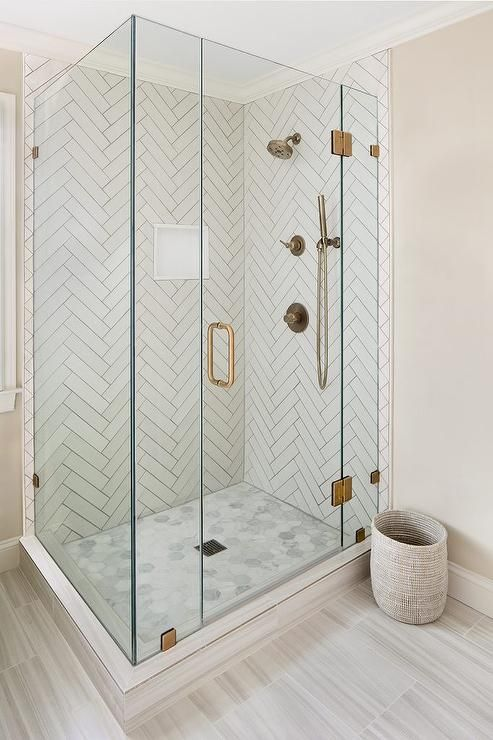 Master Bathroom Shower With White Herringbone Tiles And Gray Grout