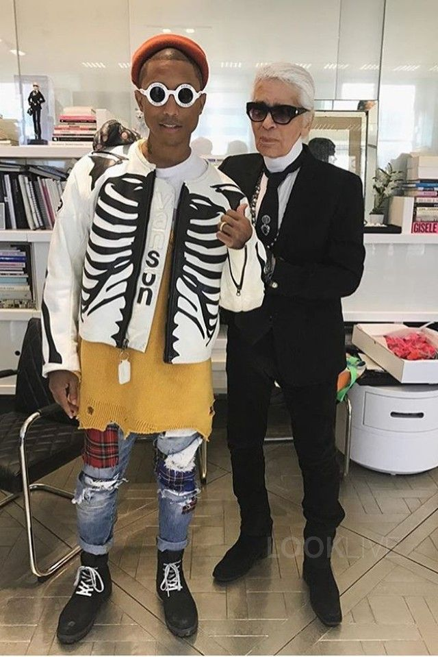 0108f54a9949b Pharrell Williams wearing Raf Simons Oversized Destroyed V-Neck Knit  Sweater