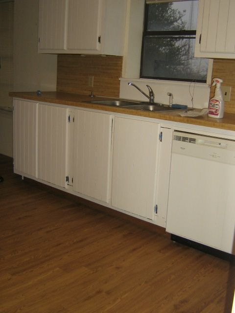 Cabinets after~ painted with two coats Behr white semi ...