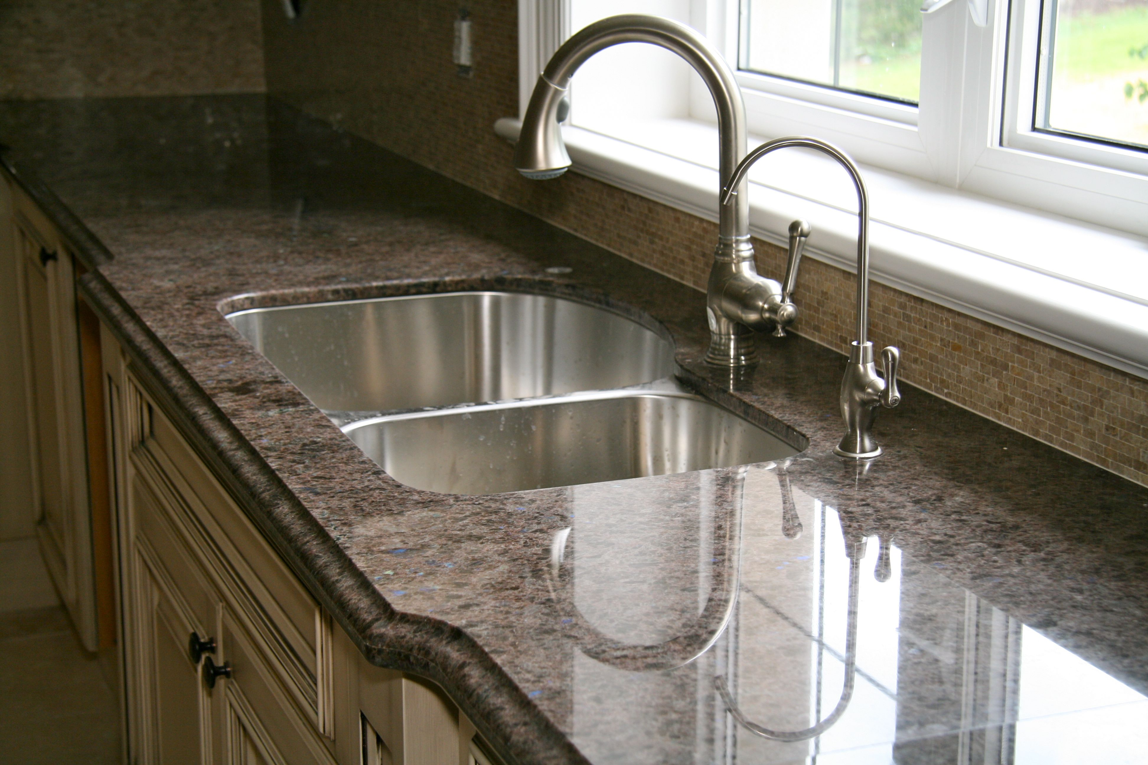 Labrador Antique Granite Www.marbleandmarble.com #labradorantique #granite  #kitchen #faucet