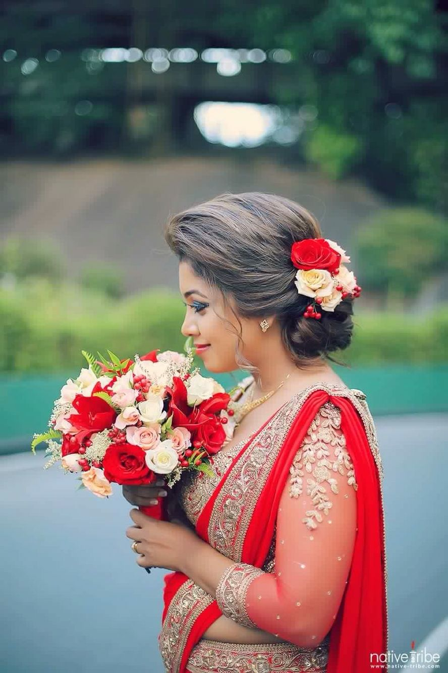 love her hair and the flowers in them; go wedding day look
