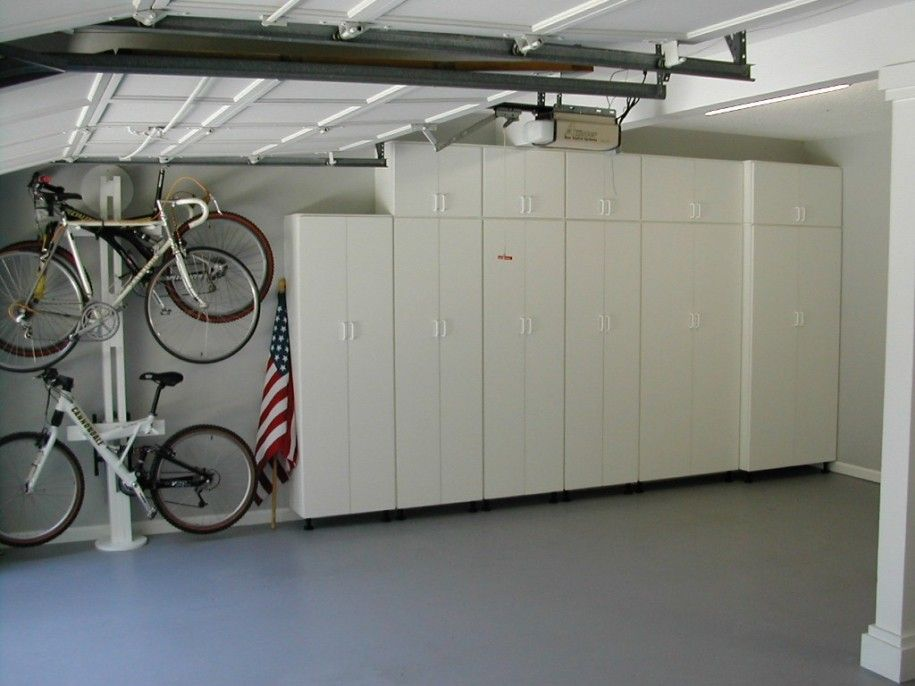 Garage Storage Cabinets For Your Minimalist And Modern Garage American Flag Mountain Bicycles Garage Interior Garage Storage Cabinets Garage Design Interior