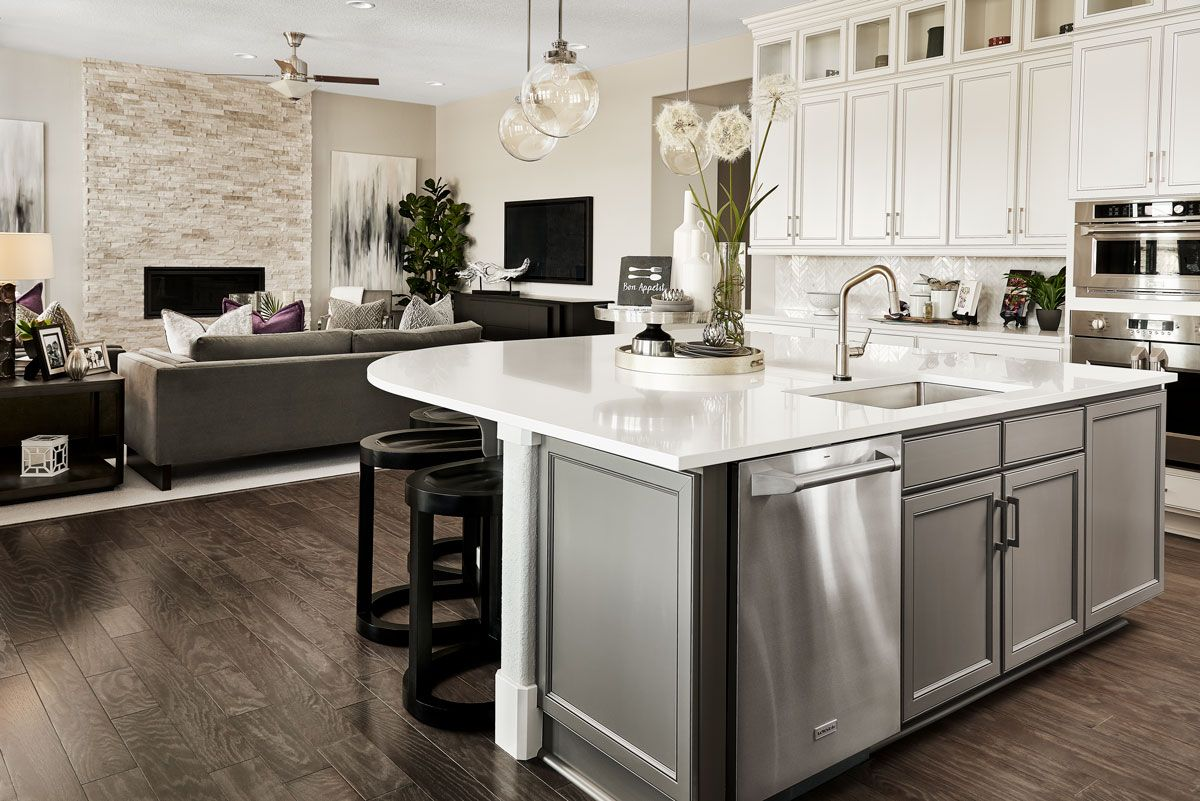 Contrasting Cabinet Colors Fabulous Floor To Ceiling Fireplace Harmon Model Home Kitchen Great Room Erie American Home Design Home Kitchens New Kitchen