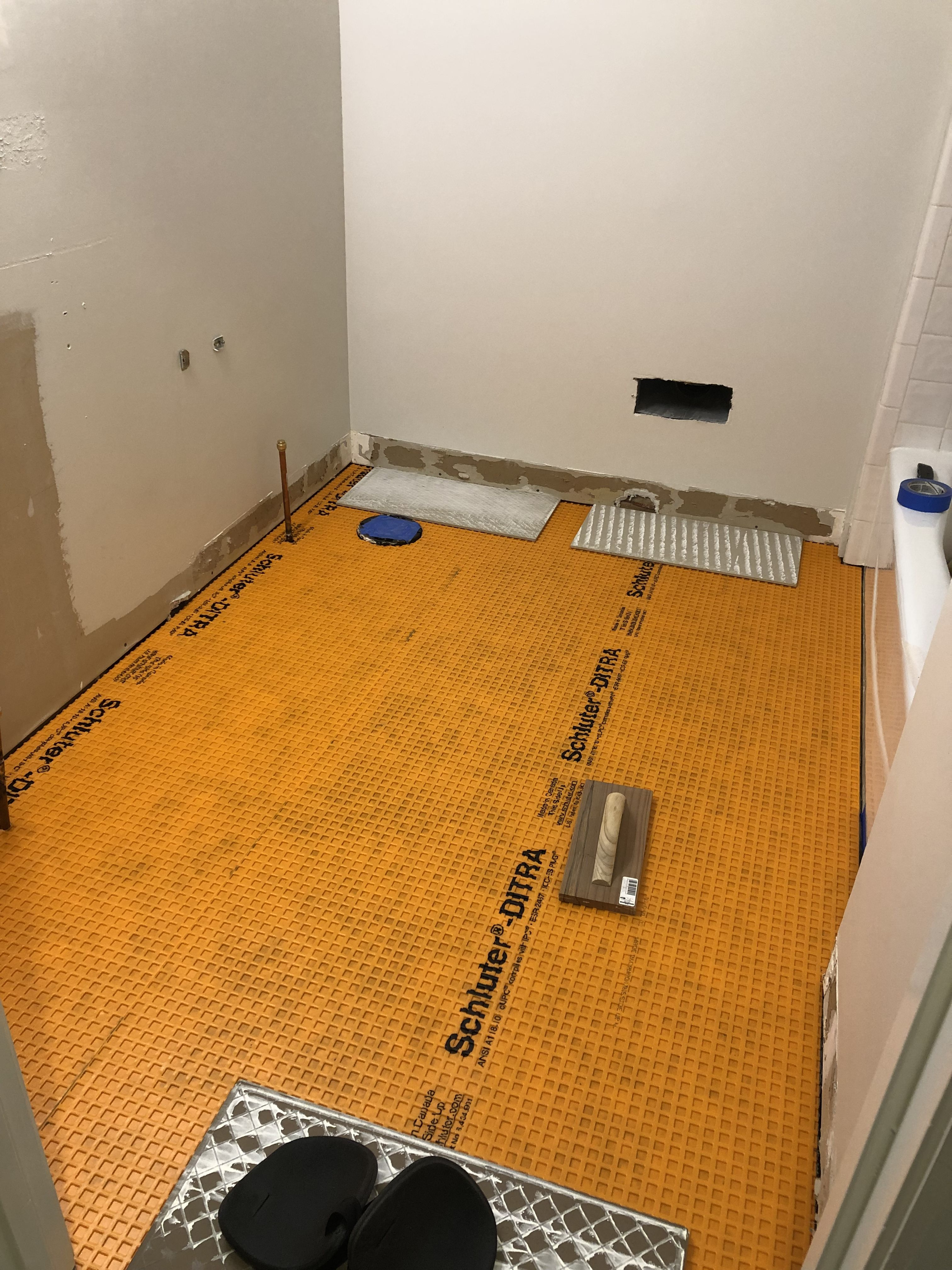 Schluter Ditra added over the plywood underlayment  | Bathroom