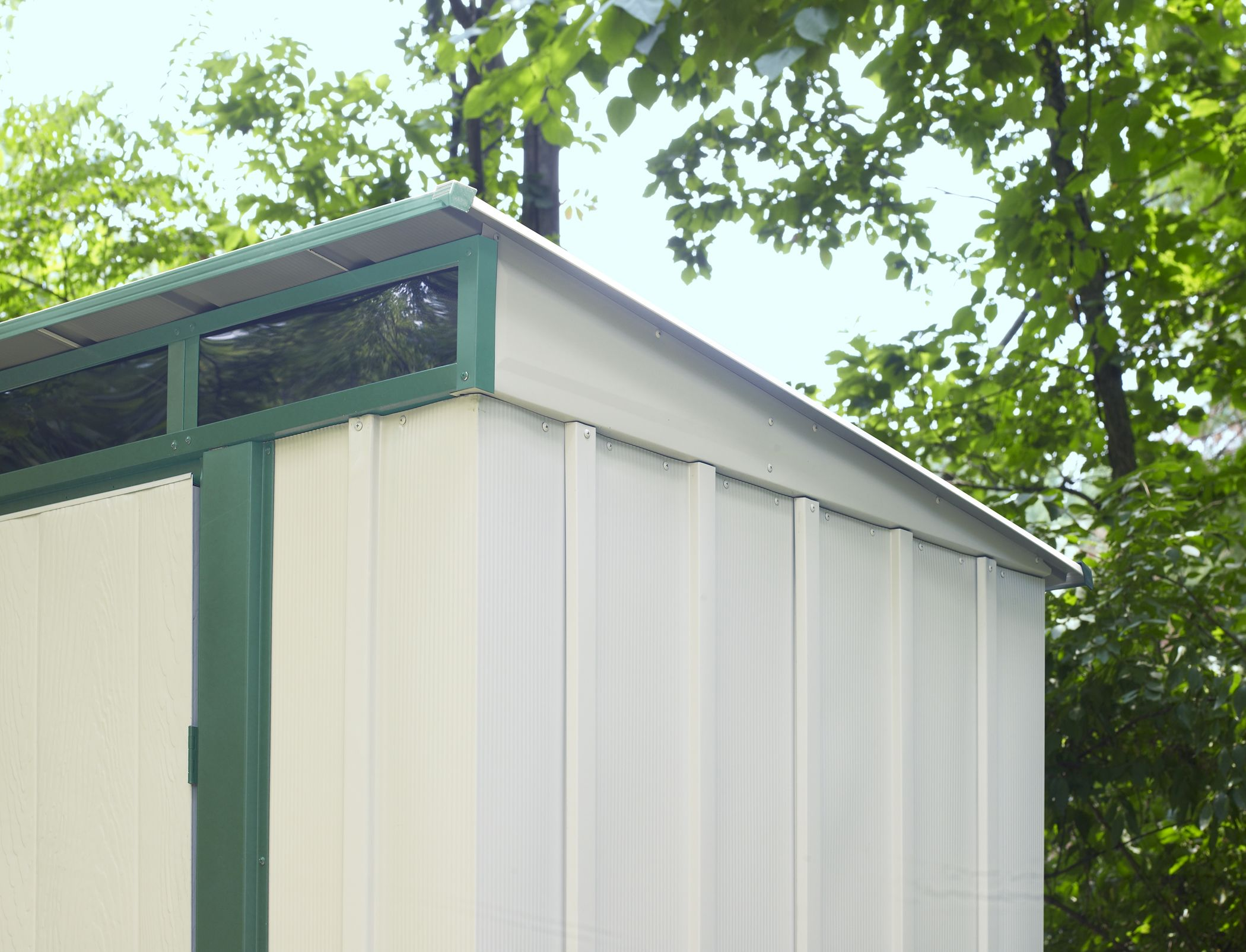 The Sloped Roof Allows For This Steel Storage Shed To Be Placed Behind A  Garage,