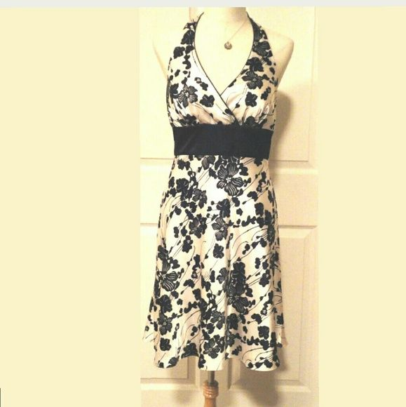 """White House Black Market Halter Dress NWOT New Without Tags WHBM Halter Dress. Fit & Flare Style. Fitted bodice. Back center zipper. Silicone along back and sides to prevent slipping. Fully lined. 100% Polyester. Chest 33"""", Length from underarm down side seam to hem 29"""". White House Black Market Dresses"""