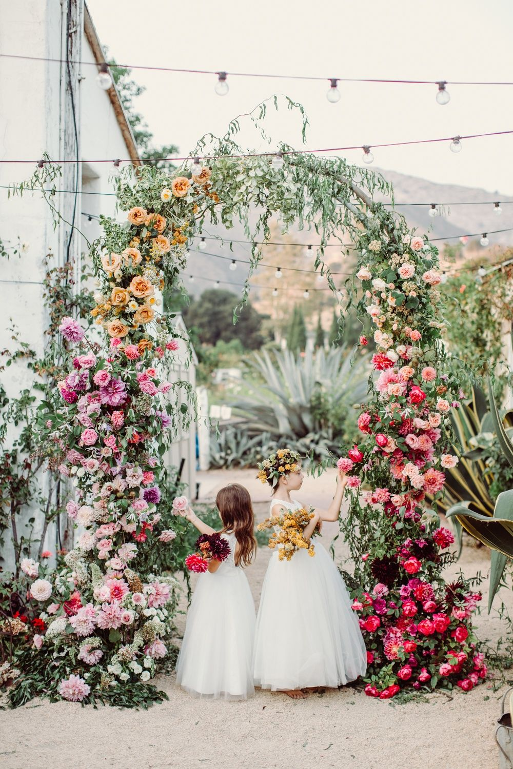 Calling All Flower Lovers This Vibrant Ombre Flower Arch Serves As The Prettiest Wedding Ceremon Floral Wedding Inspiration Floral Wedding Wedding Decorations