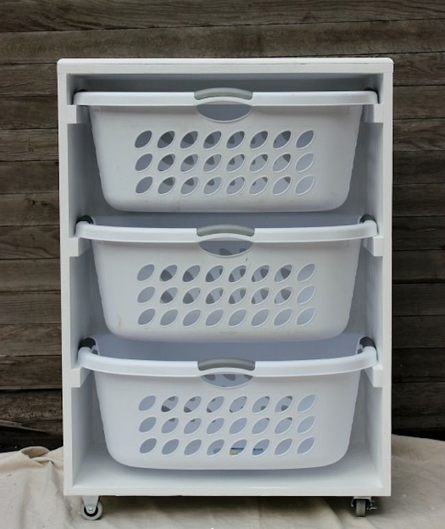 DIY Laundry Room Storage - Mobile Station... I think something like this wld be nice to have to have all ur clothes separated for when time to wash clothes.