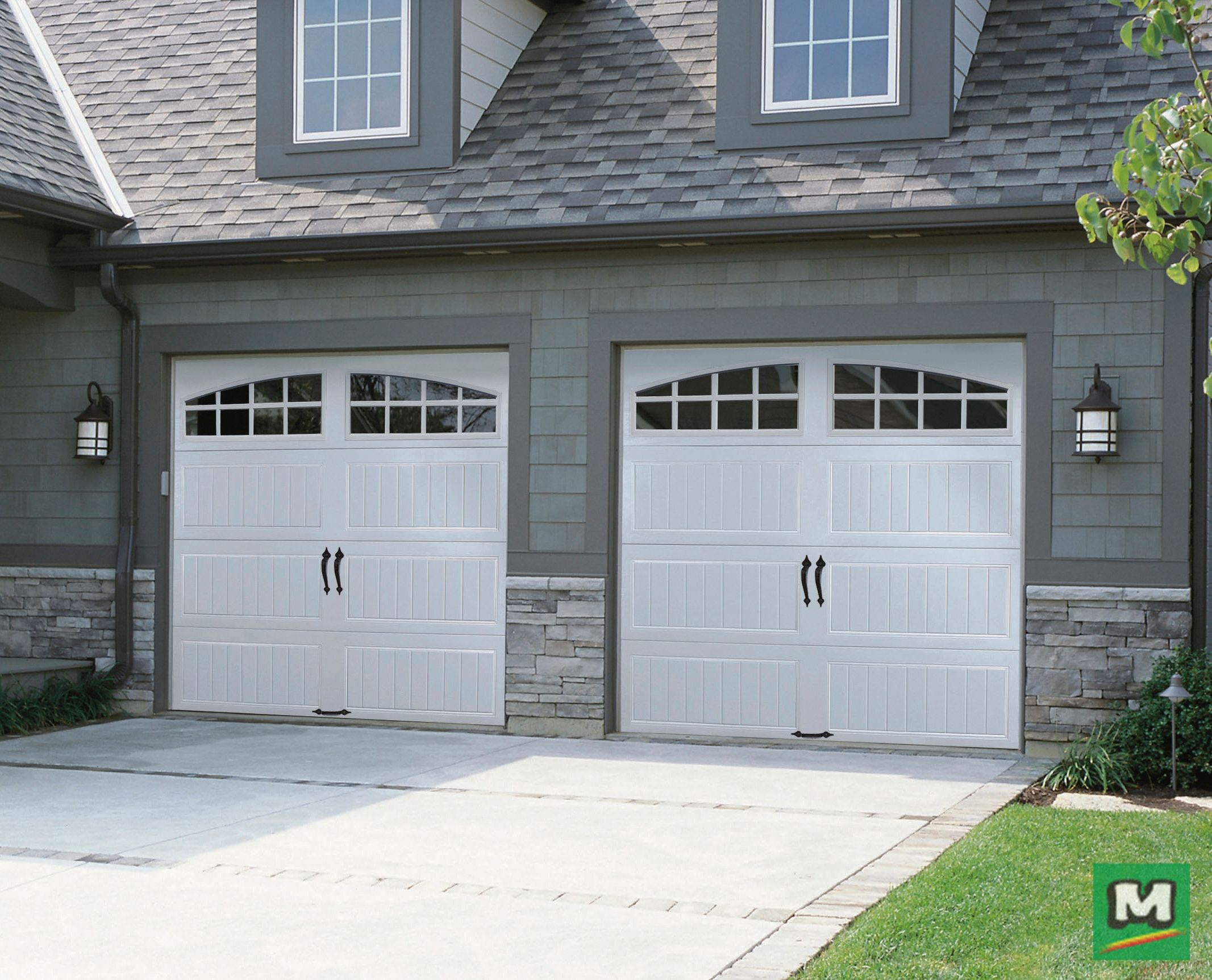 Add Curb Appeal And Energy Savings With This Ideal Door Garage Door Featuring Designer Short Panels And Arc Garage Doors Ideal Garage Doors Garage Door Styles