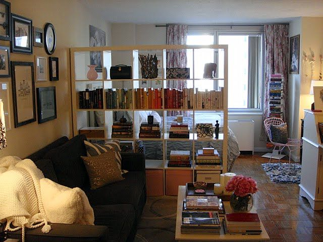 Studio Apartment Separation studio apartment - oversized bookshelf as room divide which still