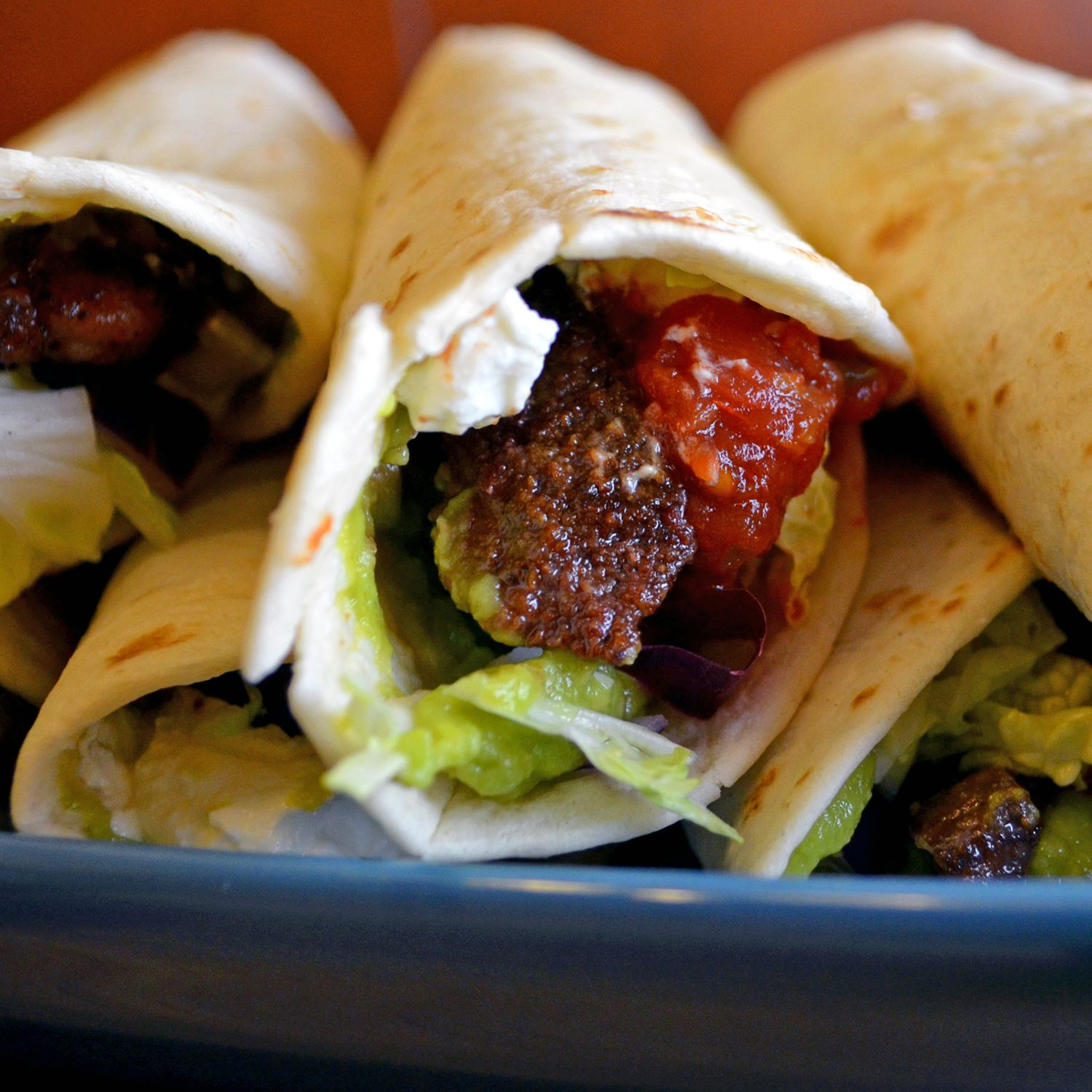 Steak Tacos with Guacamole, Salsa, and Lima Crema - Vegan w/ seitan or beefless strips, and non-dairy sour cream.
