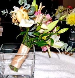 A bridal bouquet containing lilies, roses, eucalyptus and more is ready to be delivered.