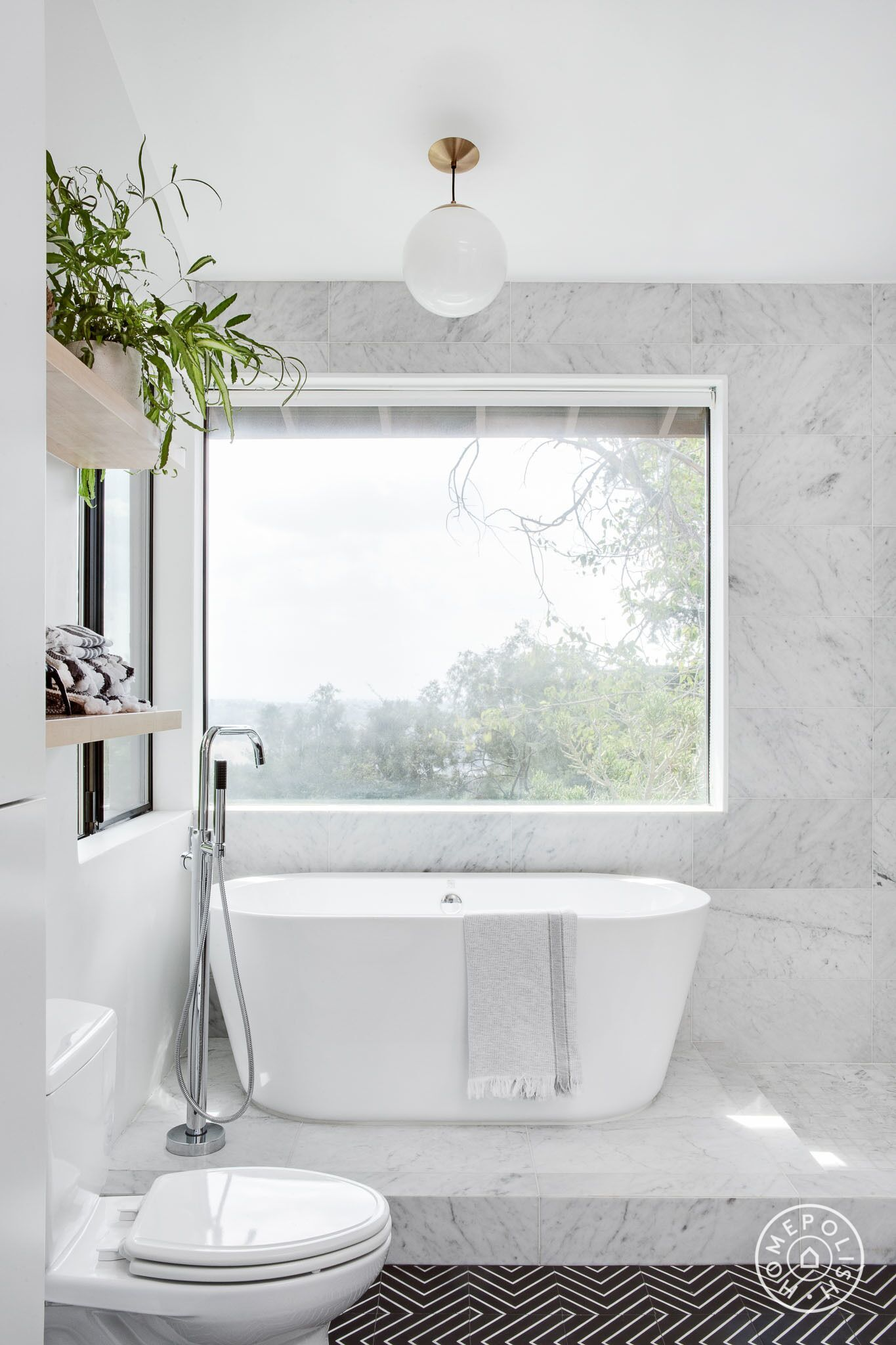 Before and After Three Bold Black and White Bathroom Renovations