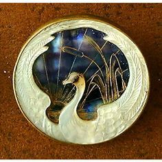 Swan design on mother-of-pearl button, c1900.