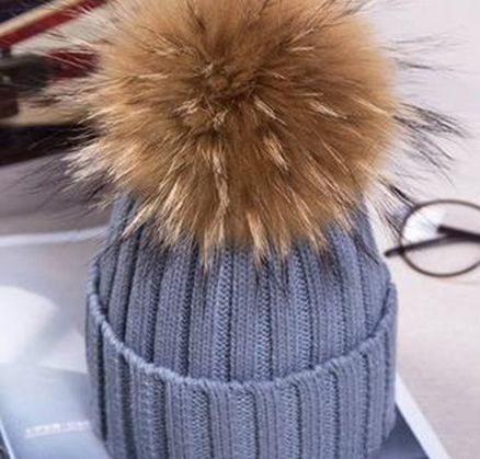 19a3e4bdd4c This beanie is topped with an oversized faux-fur pom pom Accessori  Invernali