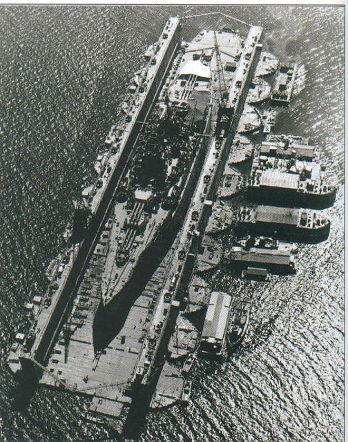US New Mexico-class battleship in floating dry dock, World War II Pacific.