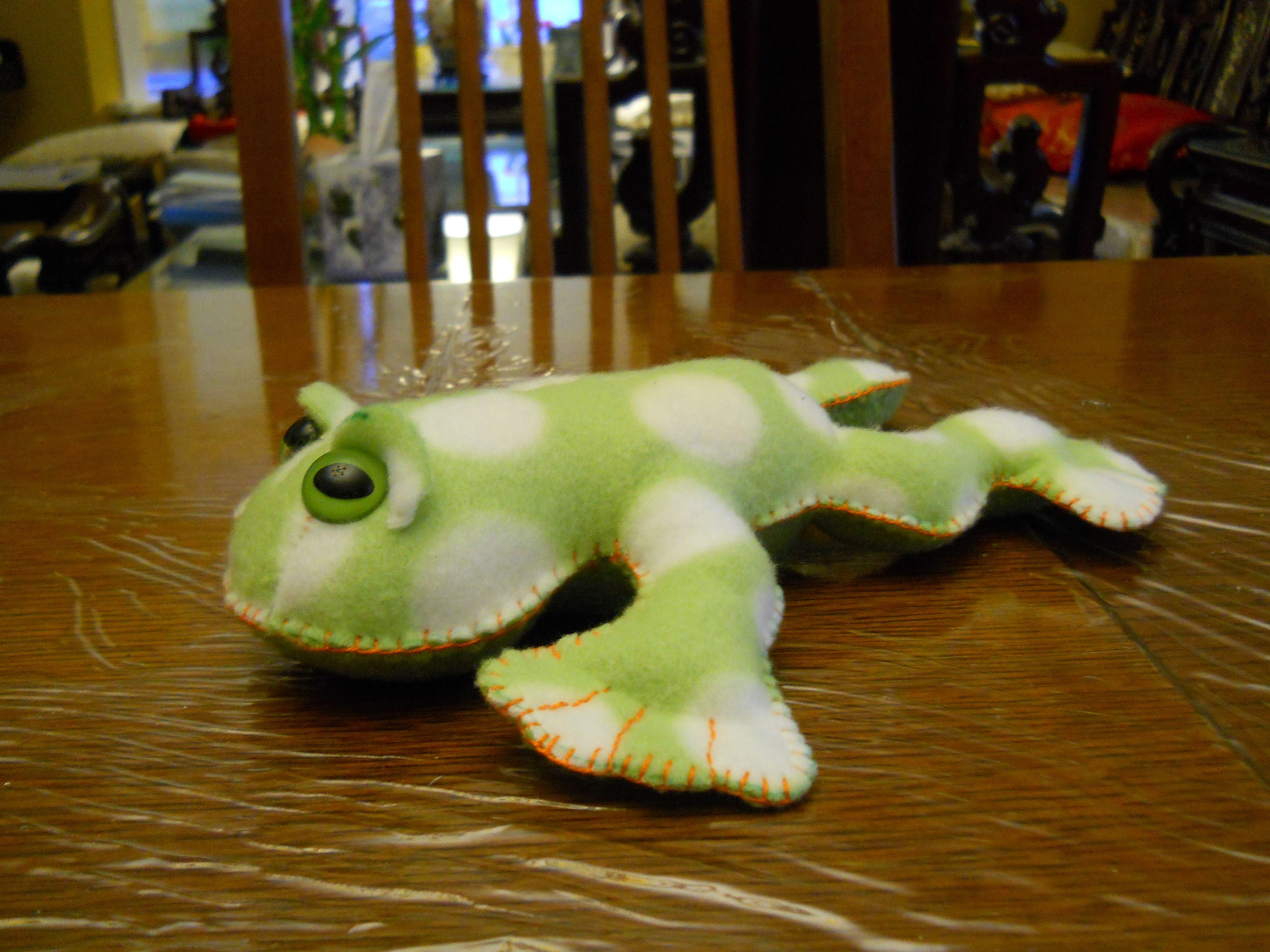 fleece froggy. took residence on Derick's nightstand.
